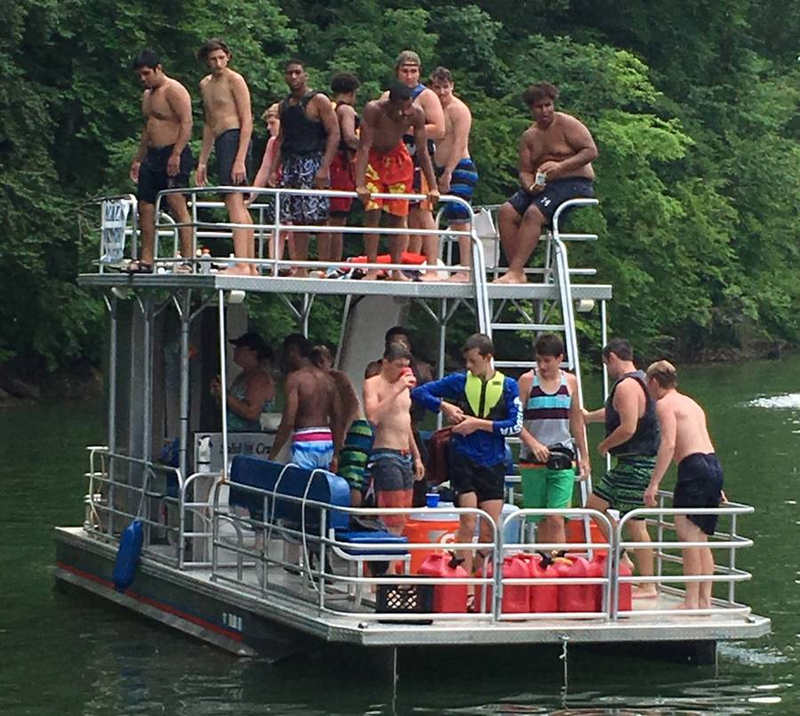 Blackman guys hanging out on the pontoon boat at Tims Ford