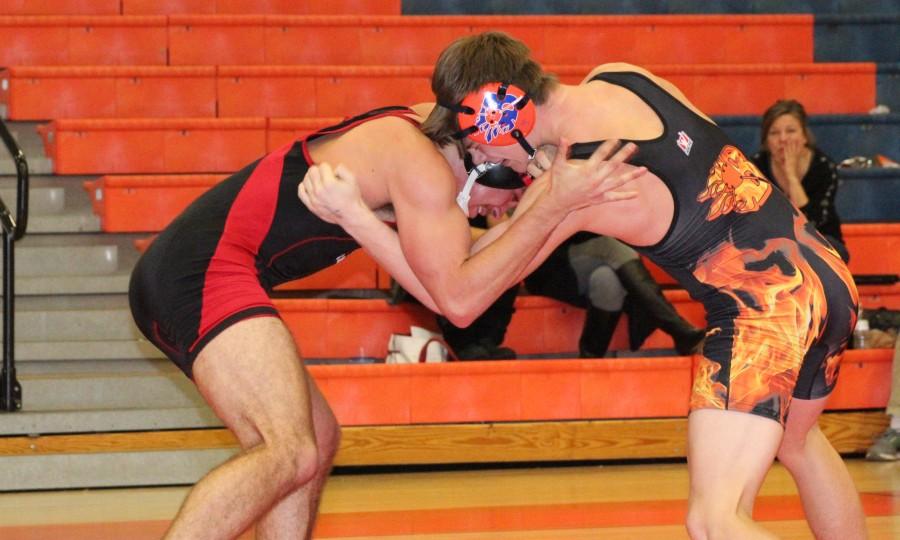 Landon Fowler ties up with Ravenwood wrestler