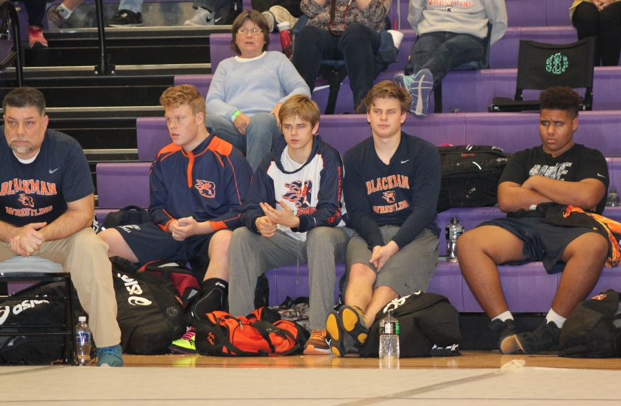Blackman Wrestlers and Coaches Look ON